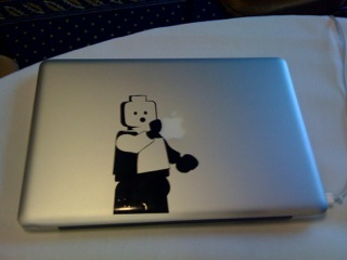 'Mac decal of lego holding an apple'